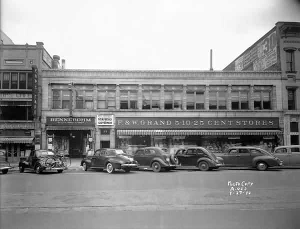 The Art Deco, Egyptian-influenced facade of the Levitan Building at 15, 17, & 19 West Main Street, including the F&W Grand 5&10 cent store, Rennebohm Drugstore #3, Cop's Cafe, and the state headquarters of Progressive gubernatorial candidate Harold E. Stafford.