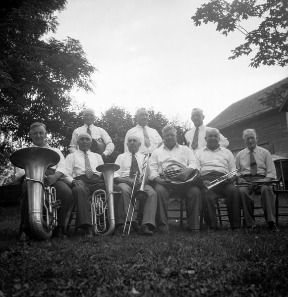Members of the Yuba (Bohemian) Band posing outdoors.