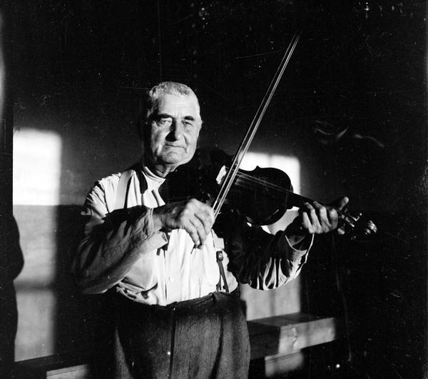 Fiddle player Emil Boulanger played for dances since he was a boy. He played entirely by ear, and on a violin which he made himself. He was born in Dyckesville (a Belgian community) and neither spoke nor understood English.
