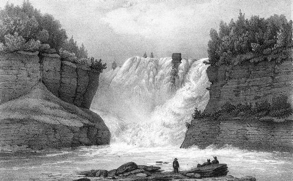 Kakabeka Falls, with men in the foreground facing the falls.