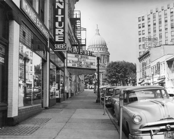 King Street, looking past the Majestic Theater, with the Wisconsin State Capitol in the background.