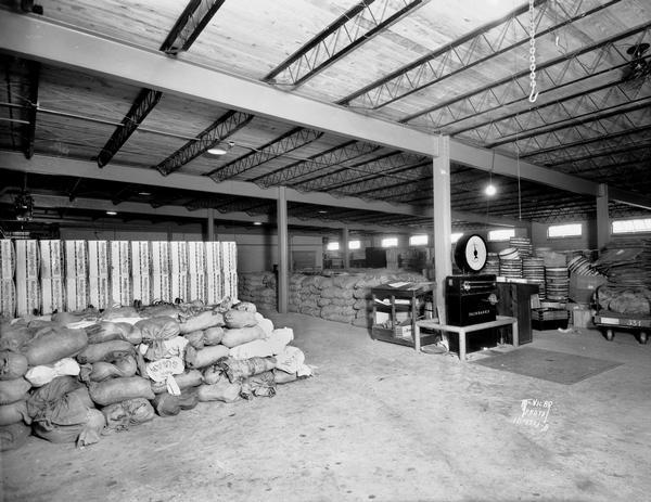 Interior of produce warehouse, Kroger Grocery and Baking Company, 634 West Washington Avenue, with sacks of sugar and a large Fairbanks scale.
