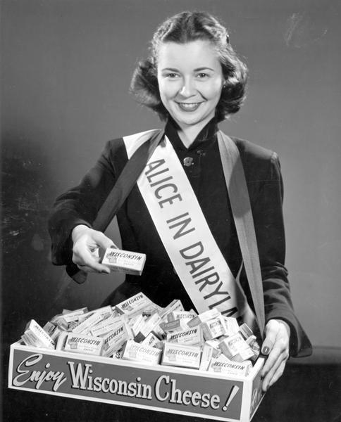 Margaret McGuire, named the first Alice in Dairyland in 1948, promotes Wisconsin cheese.