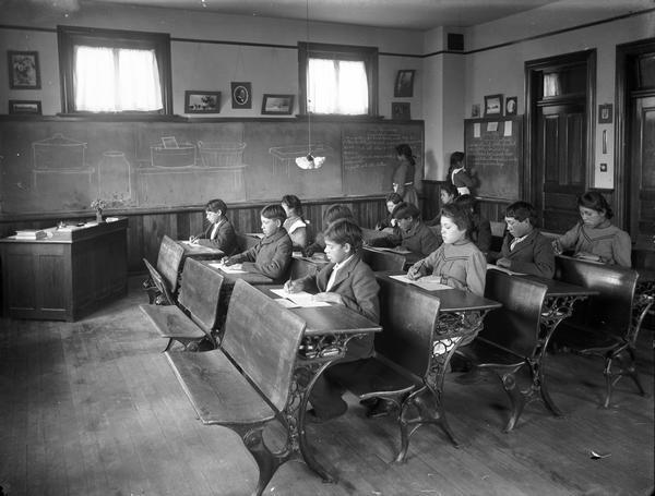 Oneida children seated at their desks in a classroom.