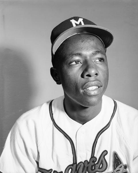 "Head and shoulders portrait of Milwaukee Braves outfielder Henry ""Hank"" Aaron in his baseball uniform. 1954 was Aaron's rookie season."
