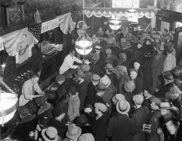 Overhead view of bar and crowd in Fauerbach Brewing Co. tavern at 651 Williamson Street, celebrating the end of Prohibition.