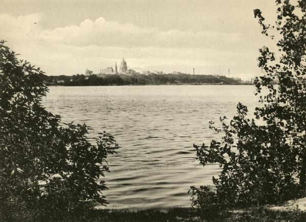 View of the Wisconsin State Capitol from Lake Monona prior to the building of the State Office Building at 1 West Wilson Street in 1923.