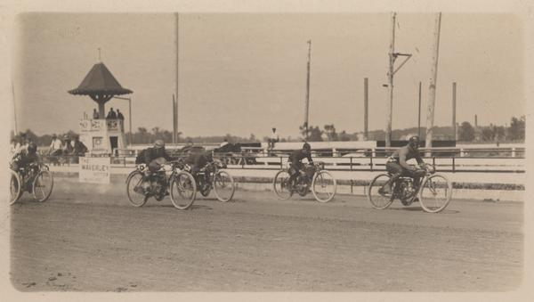 Motorcyclists race, probably at the Wisconsin State Fair Grounds.