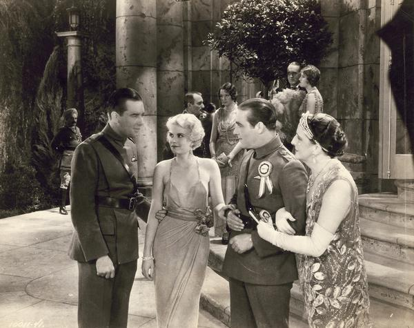 "Production still from ""Hell's Angels,"" the Howard Hughes 1930 film, which launched the career of 18-year-old Jean Harlow. She is shown here with co-stars Ben Lyon and James Hall, wearing a revealing and controversial dress.  The photograph makes clear why Harlow was destined for Hollywood stardom."