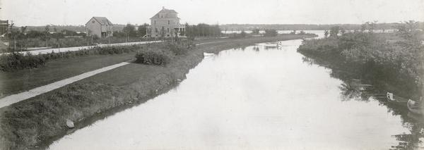 The Yahara River from Williamson Street with Lake Monona in the background.  House & Barn pictured is located at 601 Riverside Drive.