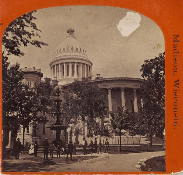 People view the third capitol building with a large fountain in front. The third Capitol was built between 1857 and 1869 and destroyed by fire on February 26, 1904.