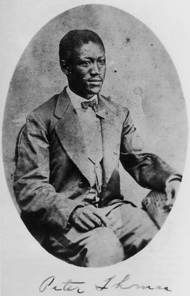 Seated portrait of Peter D. Thomas (1847-1925) of Racine.  Thomas was an escaped slave who joined the 15th Wisconsin Regiment during its service in Tennessee.  Thomas served Lt. Charles B. Nelson of Co. G at Chickamauga and other battles, then enlisted in a USCT regiment.   Later he followed Wisconsin troops back to Beloit and attended school there. In time he made his home in Racine and was elected Racine County coroner.