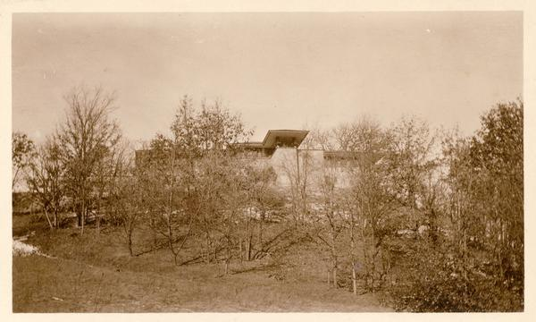 Southeast elevation of Taliesin, the home of Frank Lloyd Wright, including the covered terrace off the dining room.  The photograph was possibly made from the entrance road. Taliesin is located in the vicinity of Spring Green, Wisconsin.