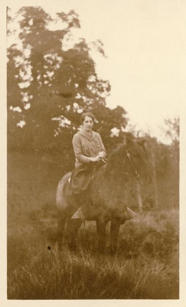 Unidentified woman on horseback, possibly near Taliesin, the home of Frank Lloyd Wright.  Taliesin is located in the vicinity of Spring Green, Wisconsin.