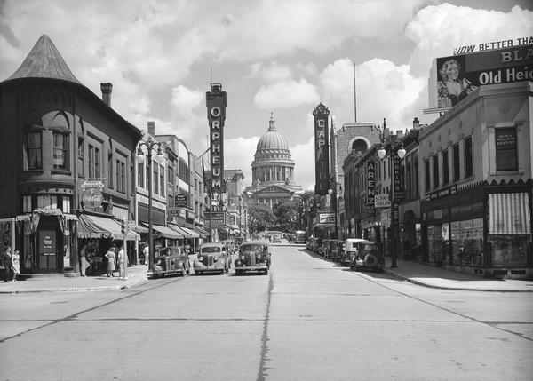 View looking east up State Street from Johnson Street, with the Orpheum and Capitol theatres on either side of the street, and the Wisconsin State Capitol.