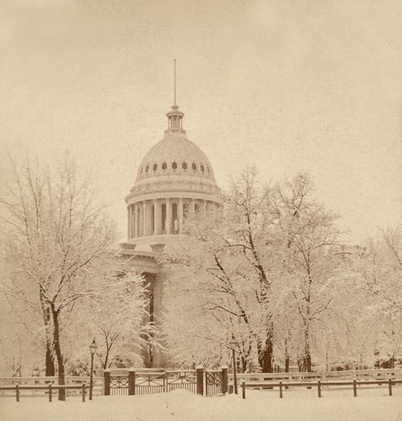 Winter view of the wooden gate to the third Wisconsin Capitol at East Washington Avenue.