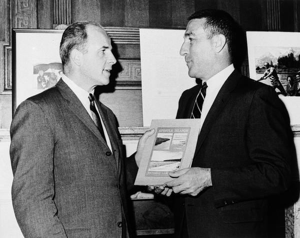 Secretary Stewart Udall presenting Secretary Gaylord Nelson with the first copy of the Interior Department task force report on the proposed Apostle Islands National Lakeshore.