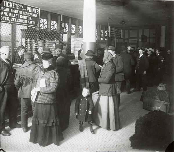 Immigrants buying tickets at Ellis Island.
