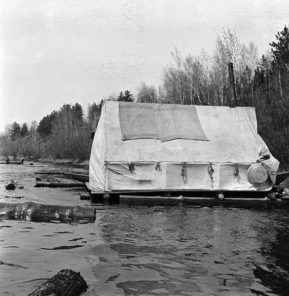 Cook's tent on a raft in the midst of a log drive on the Wisconsin  River.