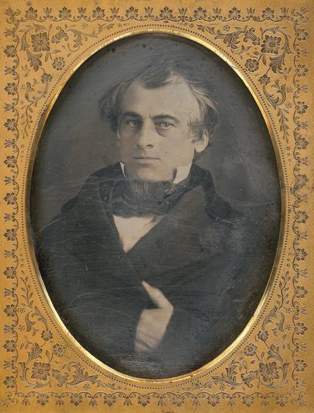 Half plate daguerreotype of Governor William Barstow (1813-1865). Quarter-length portrait, facing forward, hand-in-waistcoat.