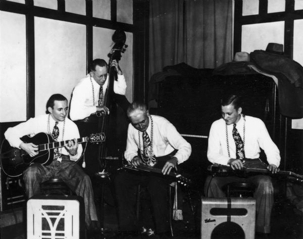 """Hawaiian Group"", a four-piece country band made up of (left to right): Martin Angus, Al Flansberg, Jack Pennywell, and George Gilbertson.  Their instruments include lap steel guitars, upright bass, and guitar."