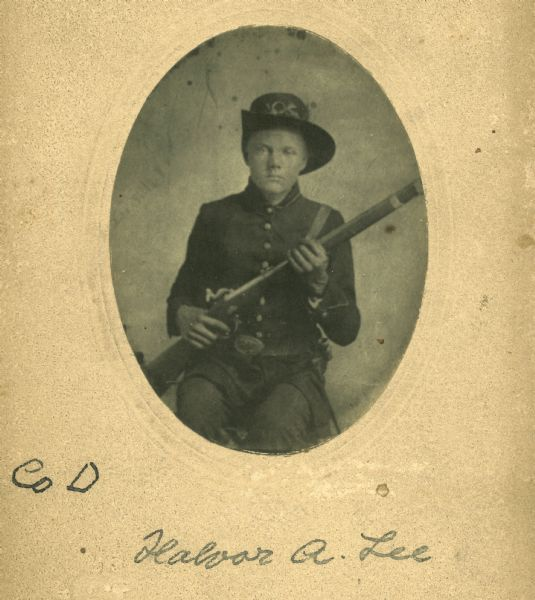 Portrait of Halvor A. Lee of the 15th Wisconsin Volunteer Infantry, Company D, holding a gun.