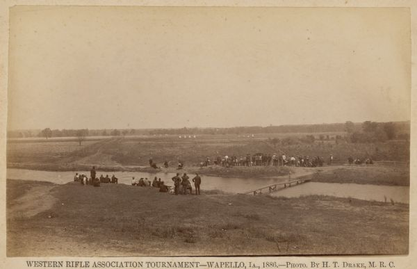 Participants, spectators, and the competition grounds of the Western Rifle Association Tournament.