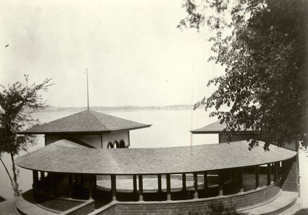 Elevated view toward Lake Mendota towards the City Boathouse, which was designed by Frank Lloyd Wright. The boathouse was at the foot of North Carroll Street. It stood from 1893 until the late 1920's.