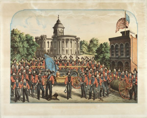 A lithographic portrait by Louis Kurz (1833-1921) of Madison Fire Engine Company #2 posed with a hand pumper and hose cart in front of the design of the new, but as yet unbuilt, Wisconsin State Capitol by architects August Kutzbock and Samuel H. Donnel. Because the new (third) Capitol was destroyed by fire in 1904, this is a somewhat ironic pairing. On the right is Station #2, 125 State Street, which was built in 1857. This building still stands although greatly altered by the Castle & Doyle Coal Co. facade.  This volunteer fire company was composed of German-American residents. The man in the central foreground is Martin Hinrichs. To his right is George Armbrecht. The first man from the left in the first row was the father of Matt Zwank of Madison. Third from the left is John Whistler, a pioneer market owner. At the extreme left in the second row from the front is Richard Baus, who operated a cigar store where the Maw-Olson store now stands. To the right of Mr. Baus is Joseph Hausmann, who was a brewer. In the fourth row back, to the left of the flag, is a man named Kessler.  One of the two torch boys in the left foreground is believed to be John B. Heim, former mayor of Madison.