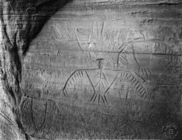 Thunderbird petroglyphs carved on rock face at Twin Bluffs.