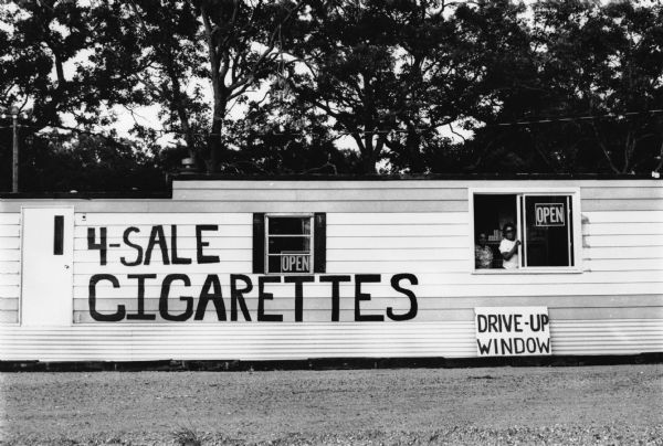 Winnebago Enterprises trailer, advertising drive-up cigarette sales.