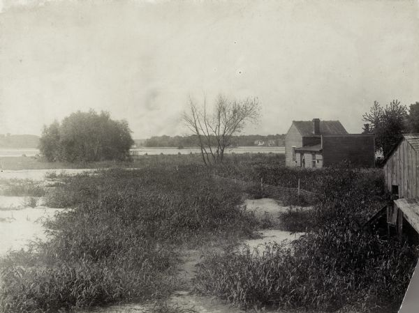 Area at the foot of West Main Street, which is now Brittingham Park. Weatherworn buildings are  on the right.