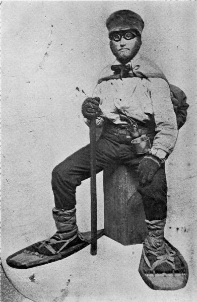 Asaph Whittlesey dressed for his journey from Ashland to Madison, Wisconsin, to take up his seat in the state legislature. Whittlesey is attired for the long trek in winter gear including goggles, a walking staff, and snowshoes.