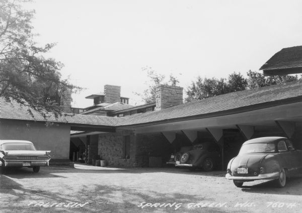Exterior view of Taliesin showing garages with several parked cars. Taliesin is located in the vicinity of Spring Green, Wisconsin.