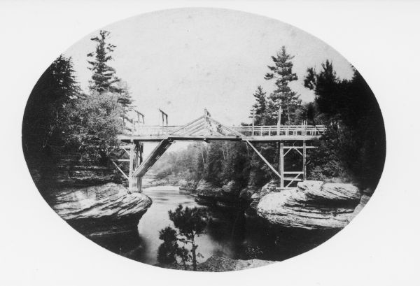 View of the first bridge to span the Wisconsin River, built by Schuyler Gates. It was washed away in 1866.