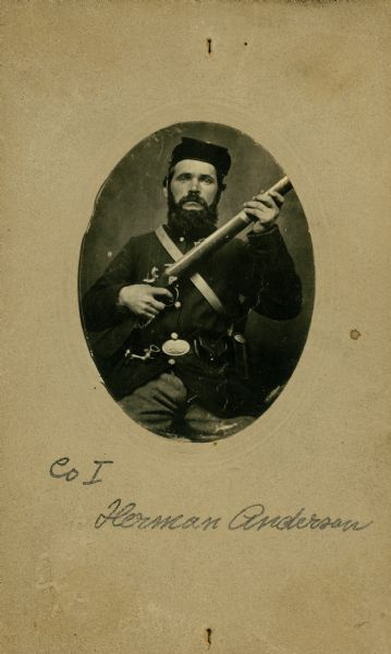 An oval-framed, seated studio portrait of Anderson Herman, a private in Company I, 15th Wisconsin Infantry in uniform, holding a musket across his chest. The following information was obtained from the Regimental and Descriptive Rolls, Volume 20: He resided in Scandinavia, Wisconsin. On November 11, 1861, he enlisted in Scandinavia, Wisconsin and was mustered into service on December 20, 1861, in Madison, Wisconsin at the age of 35. In December 1863 he was detached from the company to serve as a baker in Stevenson, Alabama. He survived the war and mustered out with Company I on February 10, 1865, at Chattanooga, Tennessee.