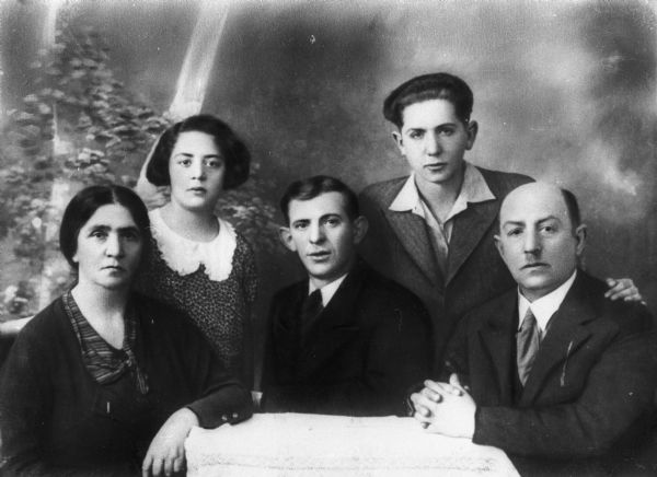 Portrait in front of a painted backdrop of the Goldberg family (from left): Sara (mother), Rosa Goldberg Katz, Uncle Hirsch, Moishe (brother), Abraham (father); Lodz, Poland.