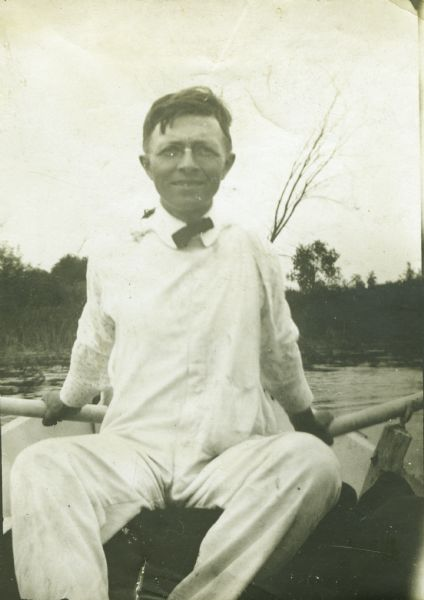 John Bordner seated in a rowboat and wearing a bow tie.