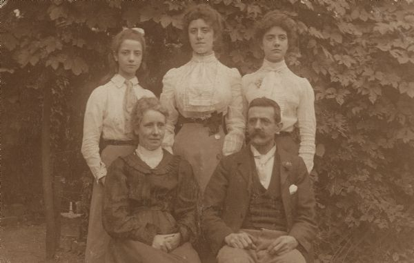 Lynn Fontanne as a girl poses with her family. Seated are Frances Ellen and Jules Pierre Antoine Fontanne. Standing left to right are Lynn, Mai, and Antoinette.