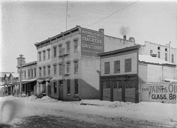 Exterior view of the Woodard & Stone Co. on the first block of North Water Street.