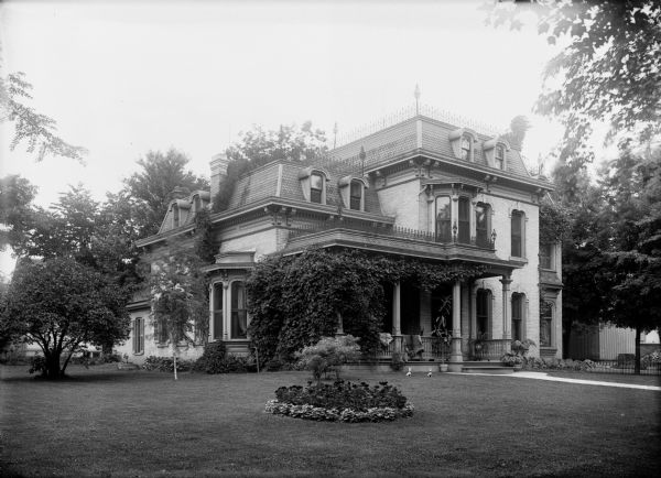 Exterior view of a grand mansion on South Washington Street.