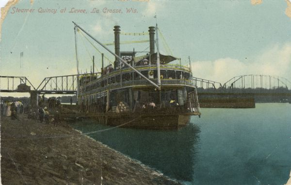 The sidewheel packet, <i>Quincy</i>, tied up at the levee. Bridge in background. Later named <i>J.S.</i>