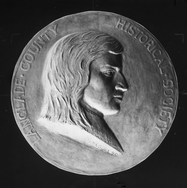 A close-up of the Langlade County Historical Society seal. It was designed by noted sculptor Sidney Bedore and bore an idealized likeness of his ancestor Charles Langlade.