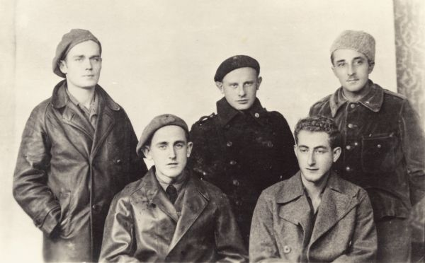 Five Wisconsin men who fought in the Abraham Lincoln Brigade in the Spanish Civil War. This was in Albacete, Spain. From left to right are Fred Palmer, Harry Lichter, Ray Disch, and seated are John Cockson and Clarence Kailin.