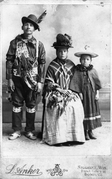 Studio portrait of the Menominee family of Kaw-hee-she-uh-quat in formal attire.