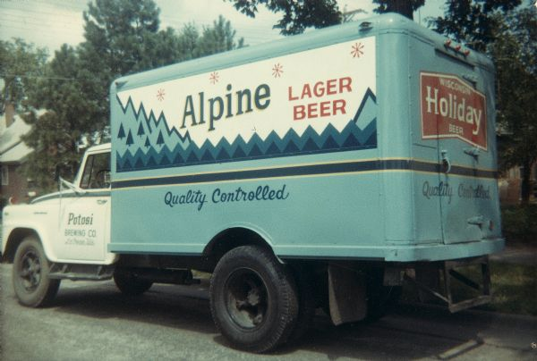 Delivery truck of the Potosi Brewing Co., highlighting two of its labels: Alpine Lager Beer and Wisconsin Holiday Beer.