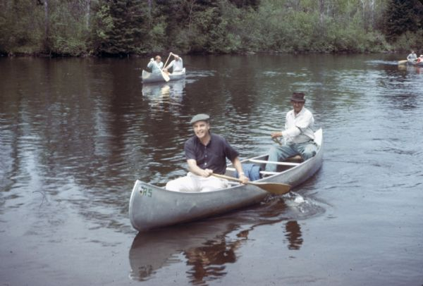 Gaylord Nelson participates in a canoe trip down the Namekagon River in an effort to protect the river under the National Wild and Scenic Rivers Act.