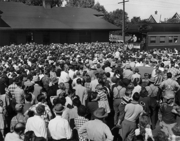 "Elevated view of Dwight D. Eisenhower addressing a huge crowd from a train platform during his ""Whistle-stop"" election drive."