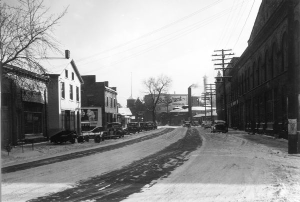 "The 600 block of Williamson Street (""Machinery Row"") with the old Fauerbach Brewery in the background."