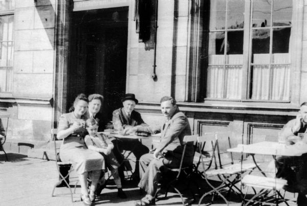 Lucy Rothstein Baras and family at outdoor cafe in Furth, Germany after World War II.  From left: Lucy Rothstein Baras, Victor (son), Edward Baras (husband), Fishel Gelbtuch, Morris Baras (Edward's brother and son-in-law of Fishel Gelbtuch).